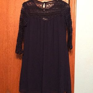 Navy blue shift dress with 3/4 sleeve.